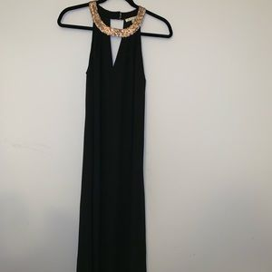 Long (floor-length) black dress with sequins